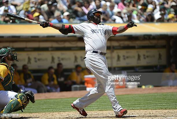 David Ortiz of the Boston Red Sox swing and watches the flight of his ball as he hits career home run a solo shot in the fourth inning against...