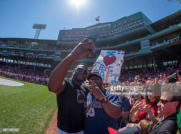 David Ortiz of the Boston Red Sox takes a selfie with a fan during a player photo fan appreciation event before a game against the Philadelphia...