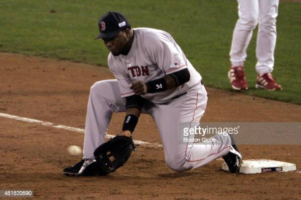 David Ortiz of the Boston Red Sox takes throw from Red Sox third baseman Bill Mueller as Albert Pujols of the St Louis Cardinals is out to end the...