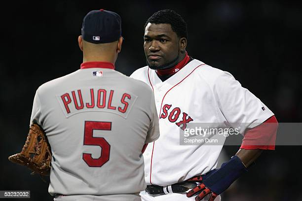 David Ortiz of the Boston Red Sox talks to Albert Pujols of the St Louis Cardinals during game one of the 2004 World Series on October 23 2004 at...