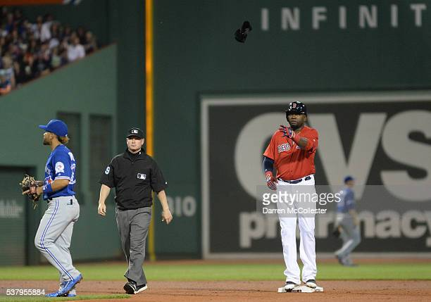 David Ortiz of the Boston Red Sox throws his batting glove in the air after hitting a double in the sixth inning against the Toronto Blue Jays at...
