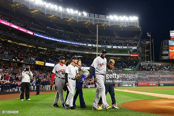 David Ortiz of the Boston Red Sox tips his cap as he is honored during a pregame ceremony at Yankee Stadium on September 29 2016 in the Bronx borough...