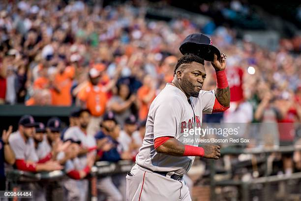 David Ortiz of the Boston Red Sox tips his cap as he is introduced during an honorary pre game ceremony for him before a game against the Baltimore...
