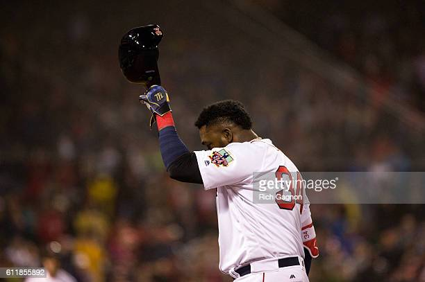 David Ortiz of the Boston Red Sox tips his helmet to the crowd as he exits the game after he singled during the fifth inning against the Toronto Blue...