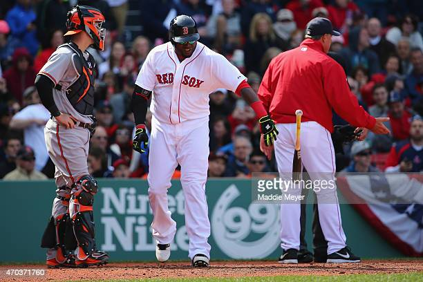 David Ortiz of the Boston Red Sox tosses his bat after being ejected during the fifth inning against the Baltimore Orioles for arguing a check swing...