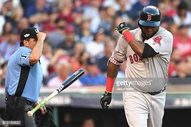 David Ortiz of the Boston Red Sox tosses his bat after flying out in the fourth inning against the Cleveland Indians during game two of the American...