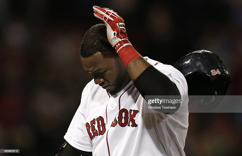 David Ortiz #34 of the Boston Red Sox tosses his batting helmet after recording the final out during the twelfth inning of their 5-3 loss to the Baltimore Orioles at Fenway Park on September 18, 2013 in Boston, Massachusetts.