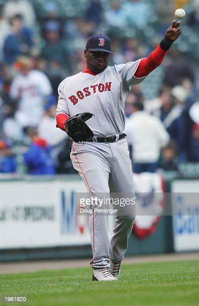 David Ortiz of the Boston Red Sox tosses the ball during the game against the Baltimore Orioles at Oriole Park at Camden Yards on April 5 2003 in...