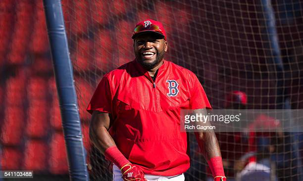 David Ortiz of the Boston Red Sox walks behind the batting cage before a game against the Seattle Mariners at Fenway Park on June 17 2016 in Boston...