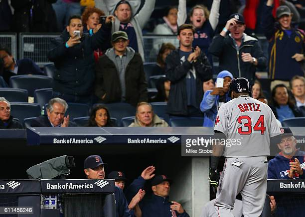 David Ortiz of the Boston Red Sox walks off the field after being pitch run for in the fourth inning against the Boston Red Sox at Yankee Stadium on...