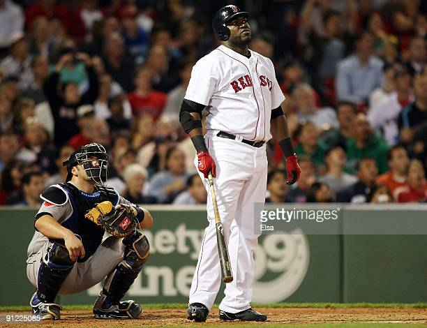 David Ortiz of the Boston Red Sox watches his solo home run as Rod Barajas of the Toronto Blue Jays defends on September 28, 2009 at Fenway Park in...