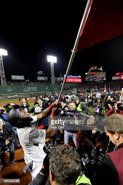 David Ortiz of the Boston Red Sox waves a flag after defeating the St Louis Cardinals 61 in Game Six of the 2013 World Series at Fenway Park on...