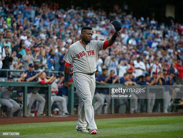 David Ortiz of the Boston Red Sox waves to the crowd during ceremonies honoring his career prior to the game against the Seattle Mariners at Safeco...