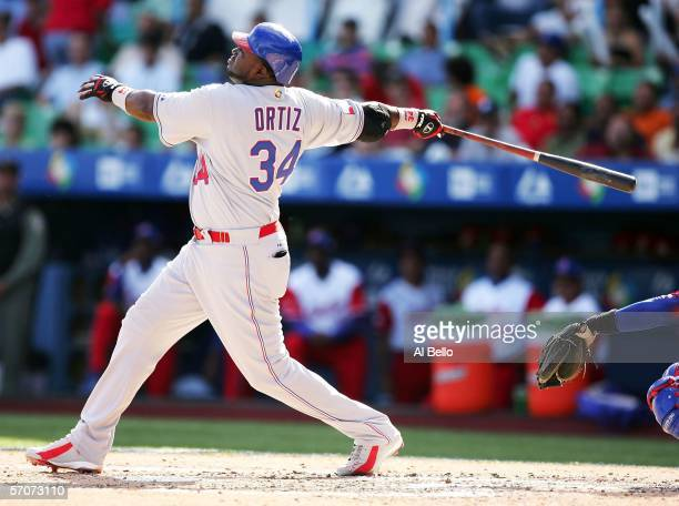 David Ortiz of the Dominican Republic swings against Cuba during Round 2 of the World Baseball Classic on March 13 2006 at Hiram Bithorn Stadium in...