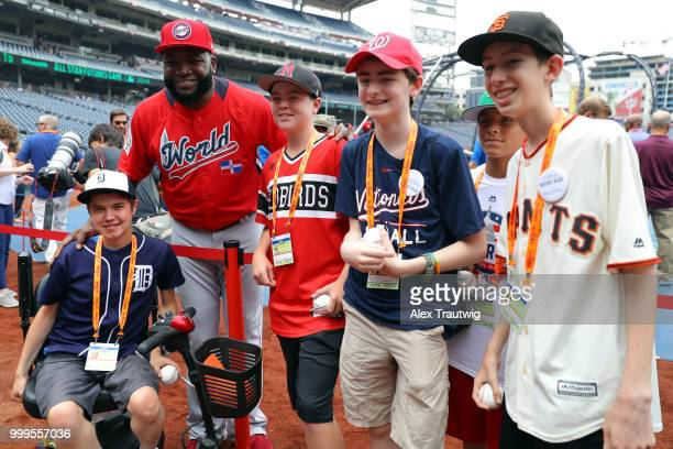 David Ortiz of the World Team poses for a photo with MakeAWish kids during batting practice prior to the SiriusXM AllStar Futures Game at Nationals...