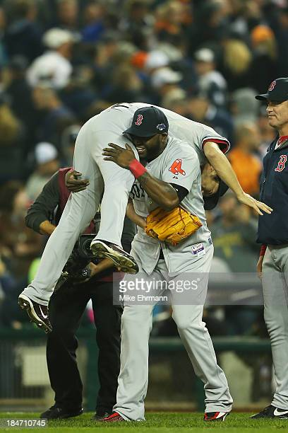 David Ortiz picks up Koji Uehara of the Boston Red Sox as they celebrate their 1 to 0 win over the Detroit Tigers in Game Three of the American...