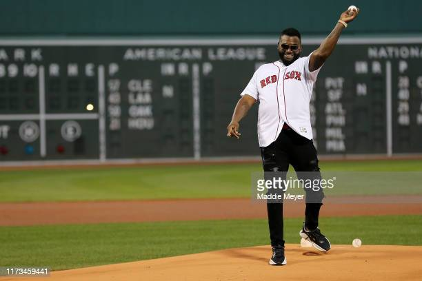 David Ortiz throws out the ceremonial first pitch before the game between the Boston Red Sox and the New York Yankees at Fenway Park on September 09,...