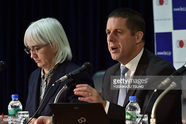 David Osborn director of the International Atomic Energy Agency Environment Laboratories speaks to the press in Tokyo on November 4 2014 while...