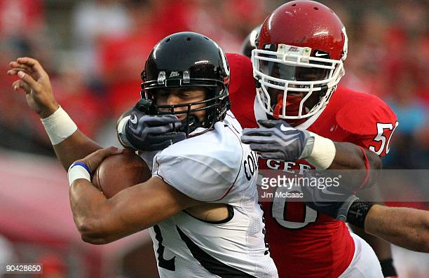 David Osei of the Rutgers Scarlet Knights tackles Zach Collaros of the Cincinnati Bearcats at Rutgers Stadium on September 7, 2009 in Piscataway, New...