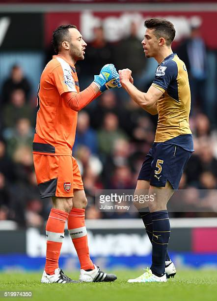 David Ospina and Gabriel of Arsenal celebrate their team's first goal during the Barclays Premier League match between West Ham United and Arsenal at...