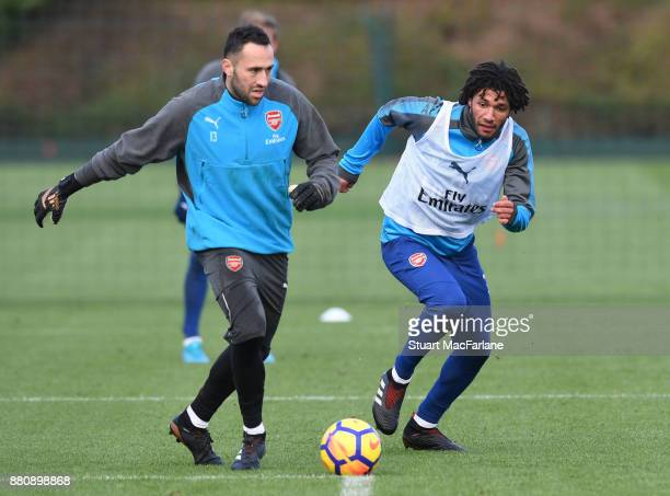 David Ospina and Mohamed Elneny of Arsenal during a training session at London Colney on November 28 2017 in St Albans England