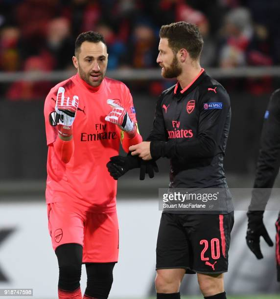 David Ospina and Shkodran Mustafi of Arsenal during UEFA Europa League Round of 32 match between Ostersunds FK and Arsenal at the Jamtkraft Arena on...