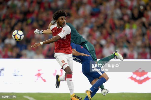 David Ospina goalkeeper for Arsenal punches the ball and catches Pedro of Chelsea as Ainsley MaitlandNiles of Arsenal looks on during the PreSeason...