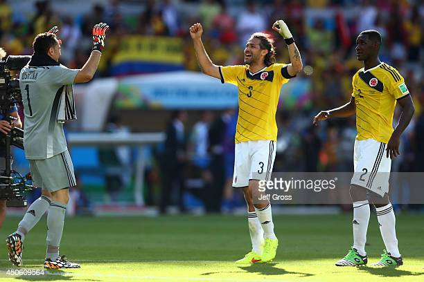 David Ospina Mario Yepes and Cristian Zapata of Colombia celebrate after defeating Greece 30 during the 2014 FIFA World Cup Brazil Group C match...