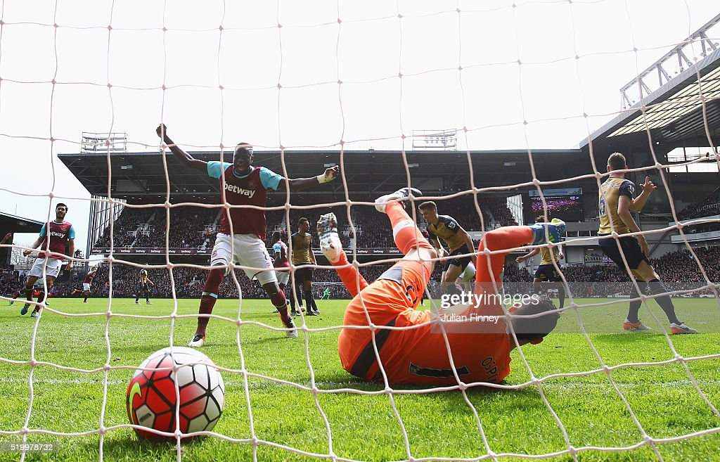David Ospina of Arsenal fails to stop as Andy Carroll of West Ham United scores his team's second goal during the Barclays Premier League match between West Ham United and Arsenal at the Boleyn Ground on April 9, 2016 in London, England.