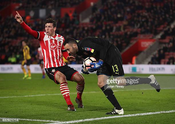 David Ospina of Arsenal gathers the ball as he is closed down by PierreEmile Hojbjerg of Southampton during the Emirates FA Cup Fourth Round match...