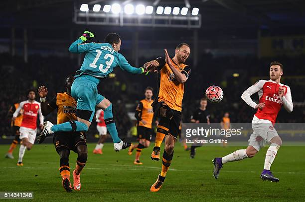 David Ospina of Arsenal punches clear from David Meyler of Hull City during the Emirates FA Cup Fifth Round Replay match between Hull City and...