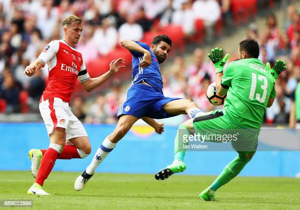 David Ospina of Arsenal saves from Diego Costa of Chelsea during The Emirates FA Cup Final between Arsenal and Chelsea at Wembley Stadium on May 27...