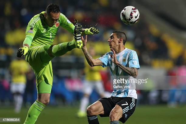 David Ospina of Colombia fights for the ball with Angel di Maria of Argentina during the 2015 Copa America Chile quarter final match between...