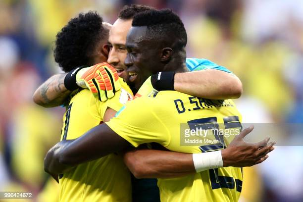David Ospina of Colombia Johan Mojica of Colombia and Davinson Sanchez of Colombia celebrate following their sides victory in the 2018 FIFA World Cup...