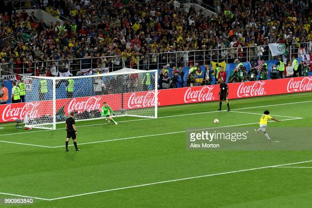 David Ospina of Colombia scores past Jordan Pickford of England his team's second penalty in the penalty shoot out during the 2018 FIFA World Cup...