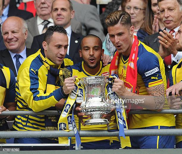 David Ospina Theo Walcott and Olivier Giroud with the FA Cup Trophy after the match between Arsenal and Aston Villa in the FA Cup Final at Wembley...