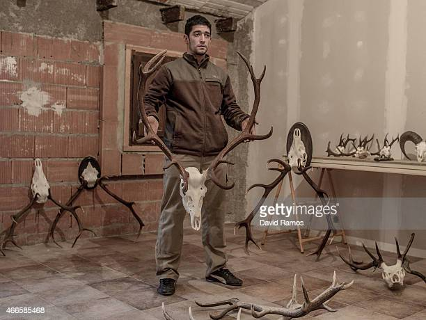 David Oter holds a dried head of deer as he poses for a portrait in Castilnuevo on February 25 2015 near Molina de Aragon Spain The economic crisis...