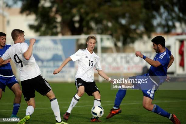 David Oto and Yari Otto of Germany in action against Zacharias Adoni of Cyprus during the U19 International Friendly between U19 Cyprus and U19...