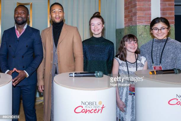 David Oyelowo John Legend and Sigrid and members of Le Petit Cirque Youth Performance Company attend the press conference ahead of the Nobel Peace...