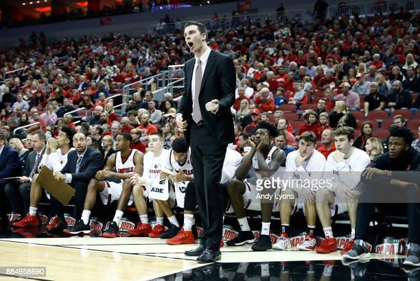 David Padgett the head coach of the Louisville Cardinals gives instructions to his team against the Seton Hall Pirates in the game at KFC YUM Center...