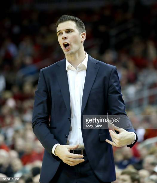 David Padgett the head coach of the Louisville Cardinals gives instructions to his team against the Siena Saints during the game at KFC YUM Center on...