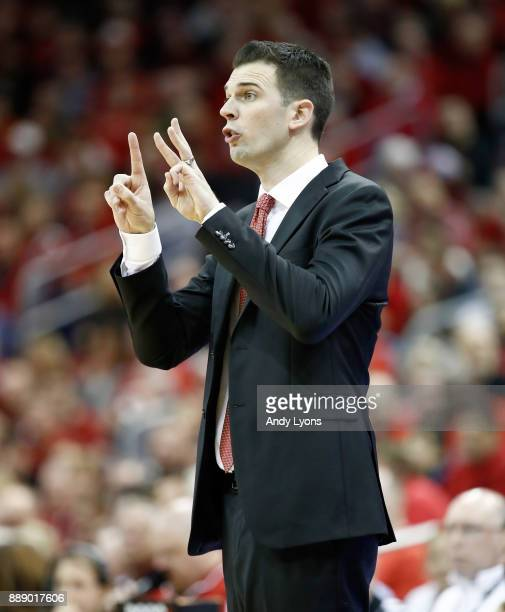 David Padgett the head coach of the Louisville Cardinals gives instructions to his team during the game against the Indiana Hoosiers at KFC YUM...