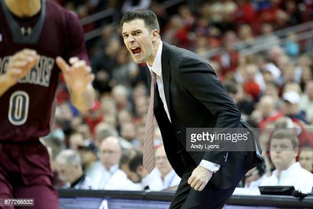 David Padgett the interim head coach of the Louisville Cardinals gives instructions to his team in the game against the Southern Illinois Salukis at...