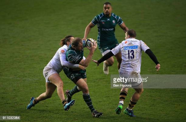 David Paice of London Irish is tackled by Jacob Umaga of Wasps during the AngloWelsh Cup match between London Irish and Wasps at Madejski Stadium on...