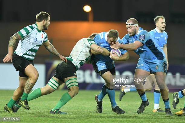 David Paice of London Irish is tackled during the European Rugby Challenge Cup match between Krasny Yar and London Irish at Avchala Stadium on...