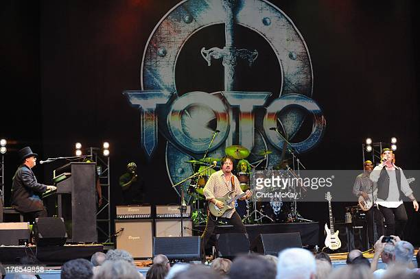 David Paich Steve Lukather Simon Phillips Nathan East and Joseph Williams of Toto perform at Chastain Park Amphitheater on August 14 2013 in Atlanta...