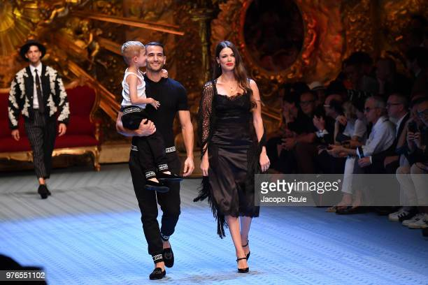 David Palacios Enrique Palcios and Veronica Schneider walk the runway at the Dolce Gabbana show during Milan Men's Fashion Week Spring/Summer 2019 on...