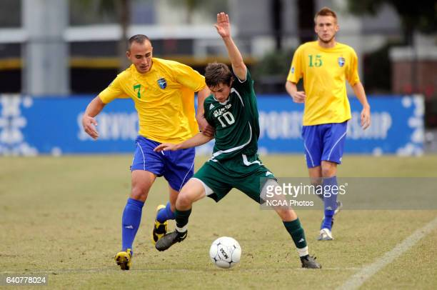 David Palmer of LeesMcRae and Dimo Krymanidis of Fort Lewis battle for the ball during the Division II Men's Soccer Championship held at Pepin...