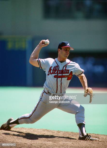 David Palmer of the Atlanta Braves pitches against the Pittsburgh Pirates during a Major League Baseball game at Three Rivers Stadium in 1987 in...