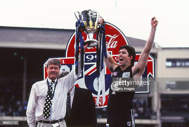 David Parkin and Stephen Kernahan of the Carlton Blues hold aloft the premiership trophy after winning the 1995 AFL Grand Final match between Carlton...